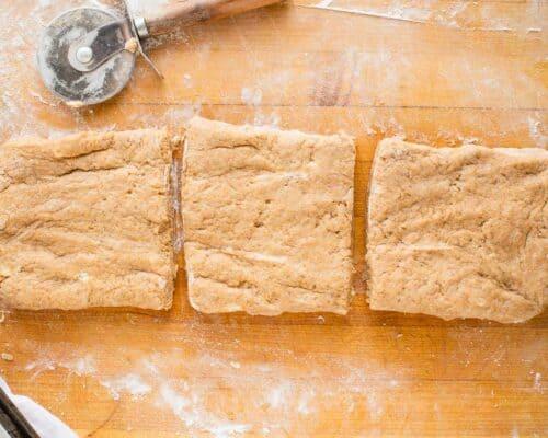 cutting dough on cutting board