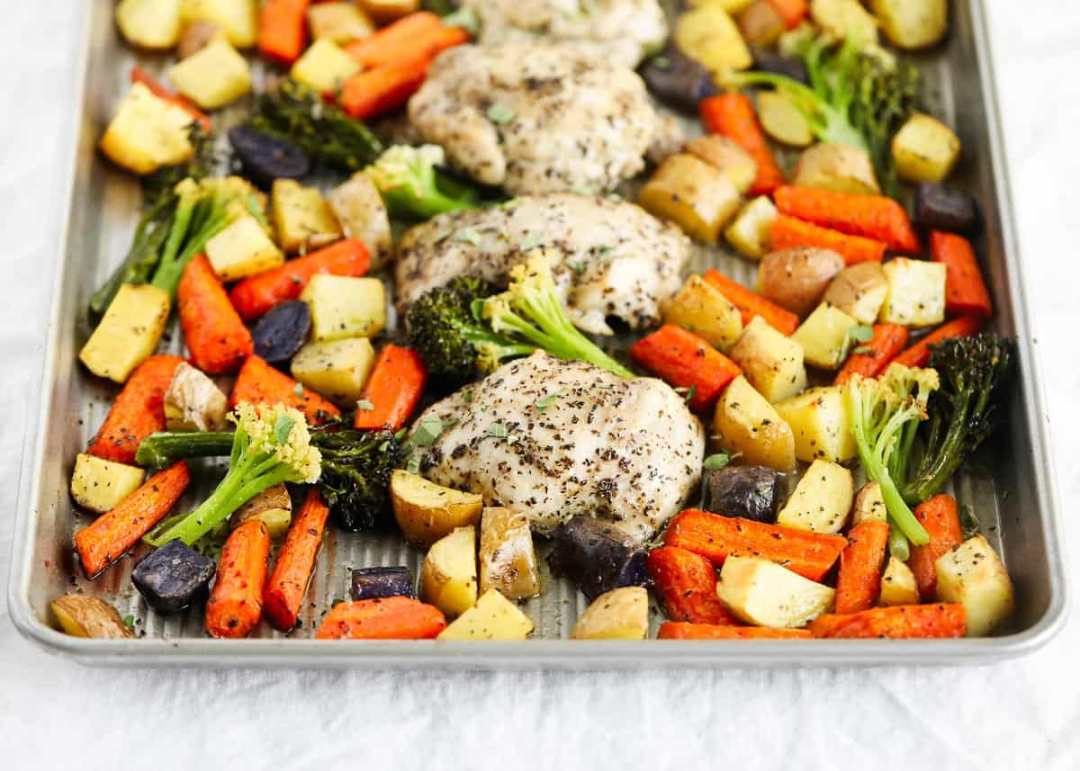 chicken thighs and vegetables on sheet pan