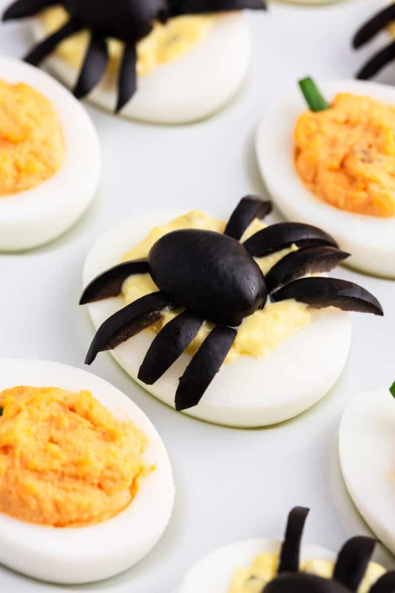 Halloween deviled eggs on white plate