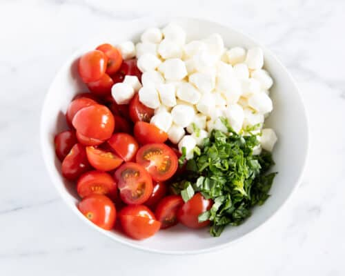 tomatoes, basil and mozzarella in bowl