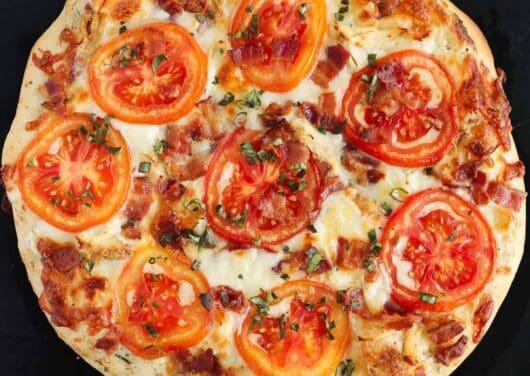chicken bacon ranch pizza on black pizza stone