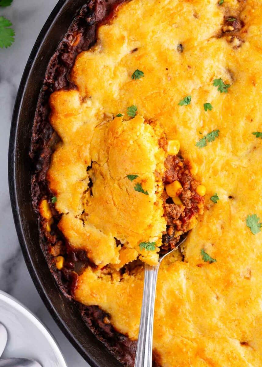spoonful of chili cornbread skillet