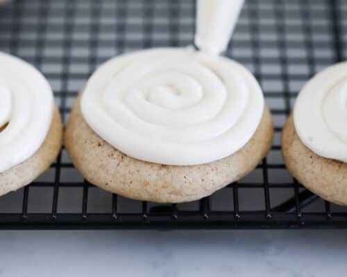 frosting cookies on cooling rack
