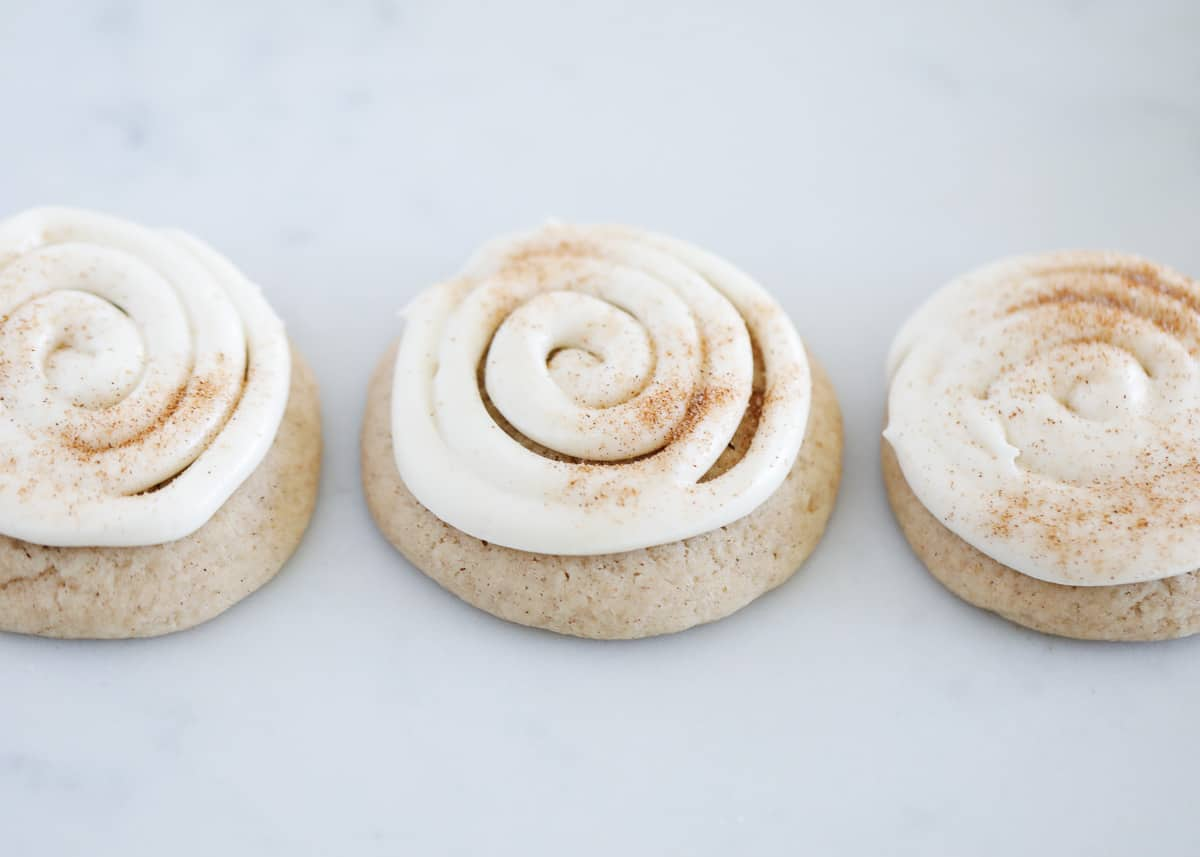 frosted cinnamon roll cookies on counter