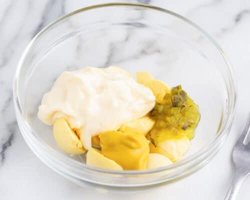 deviled eggs ingredients in bowl