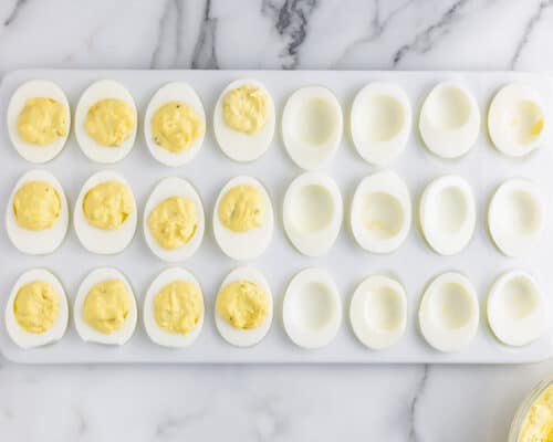 deviled eggs cut in half on white plate