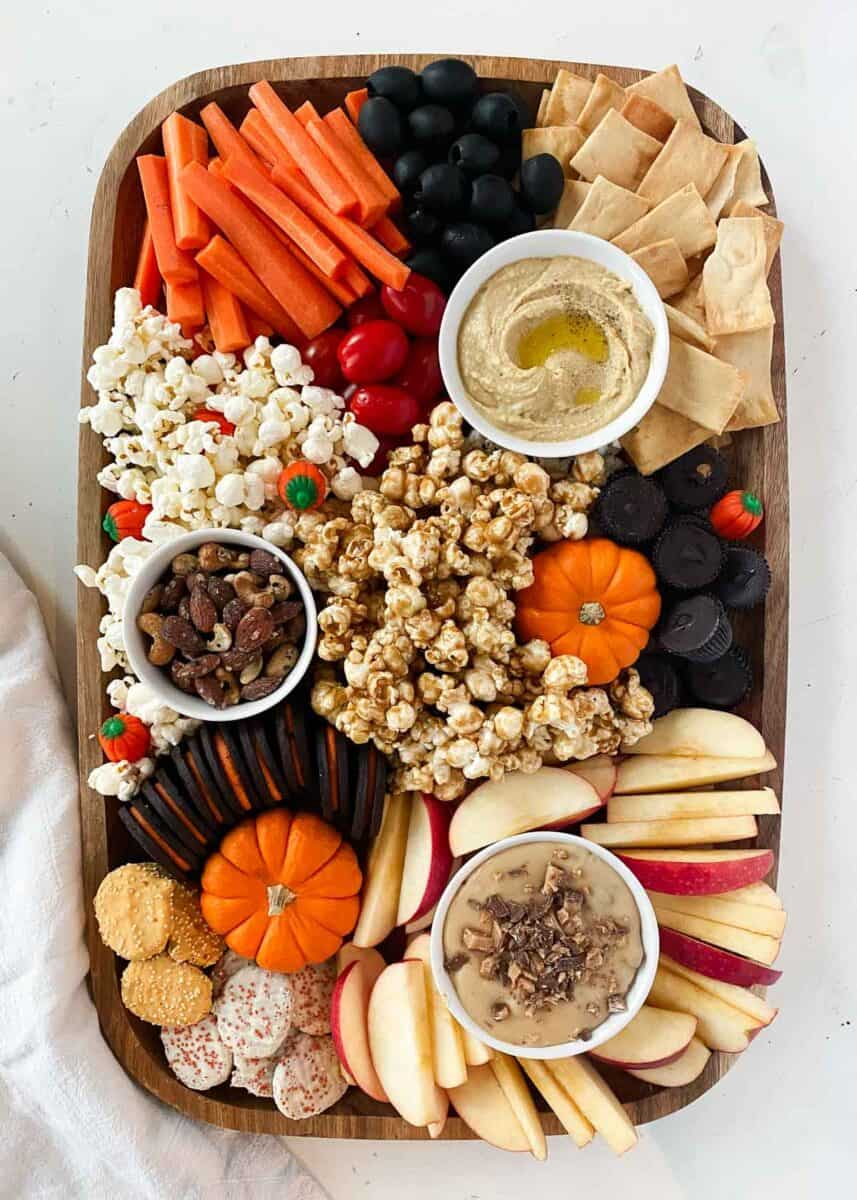 fall charcuterie board with pumpkins