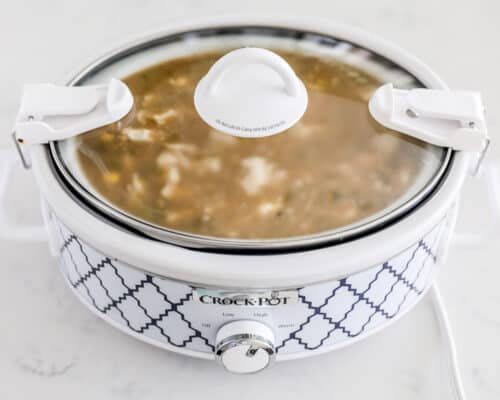 green enchilada chicken soup in crock pot with lid