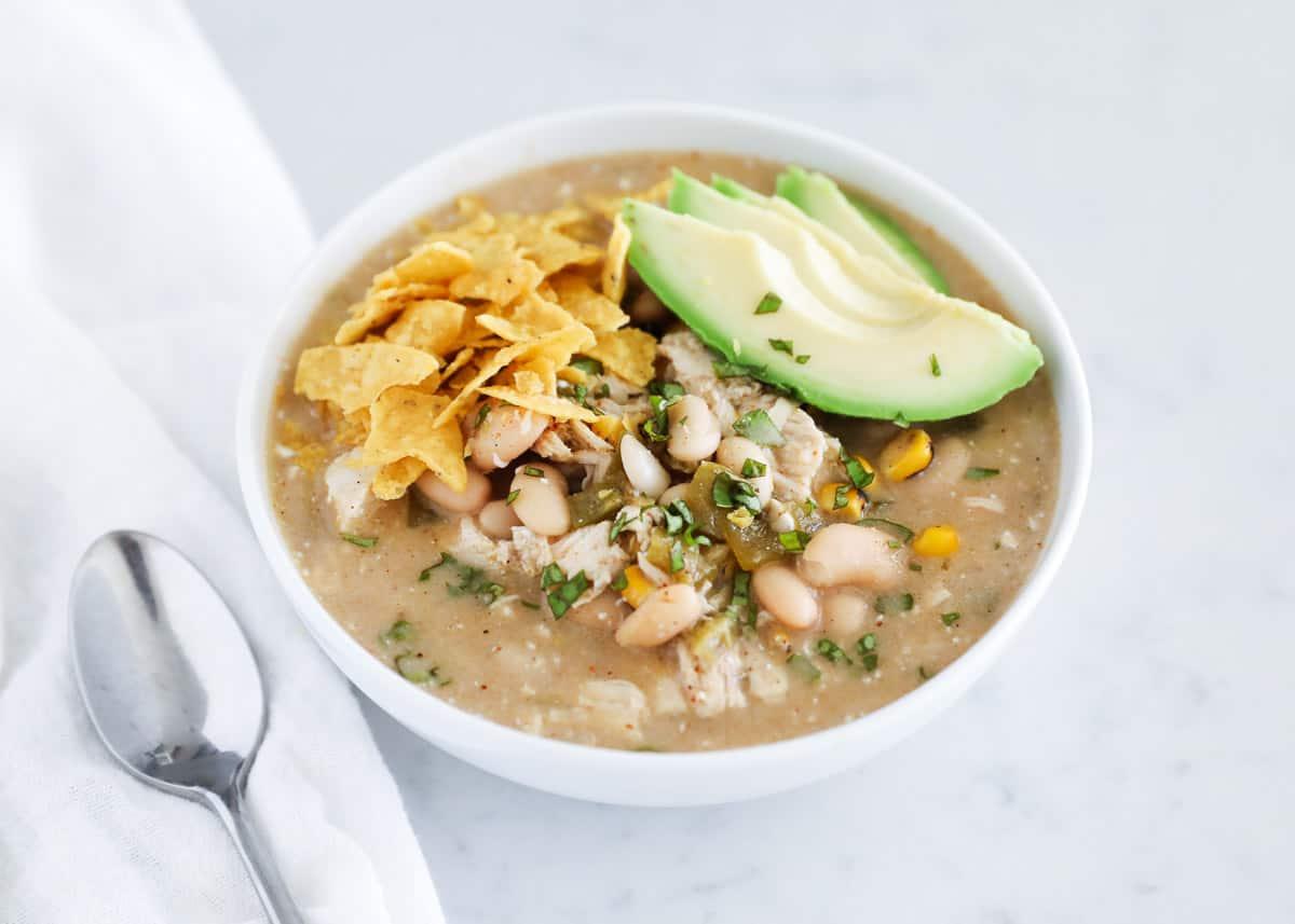 green enchilada chicken soup in bowl