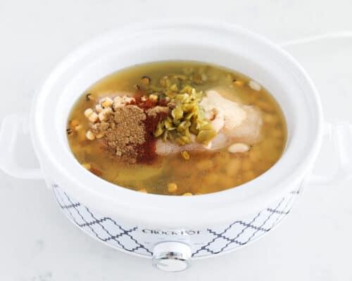 green enchilada chicken soup ingredients in slow cooker