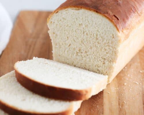 sliced bread loaf on cutting board