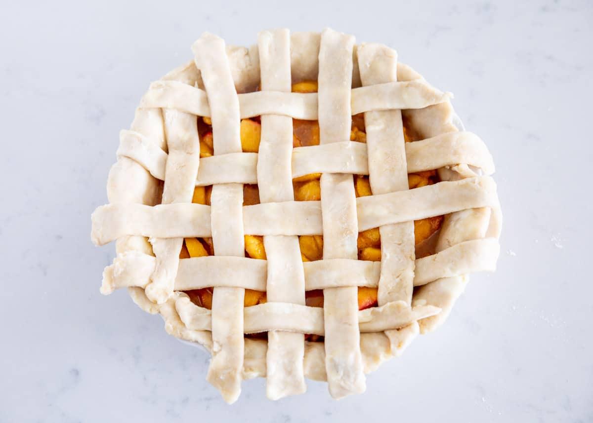 lattice pie crust on top of peach pie