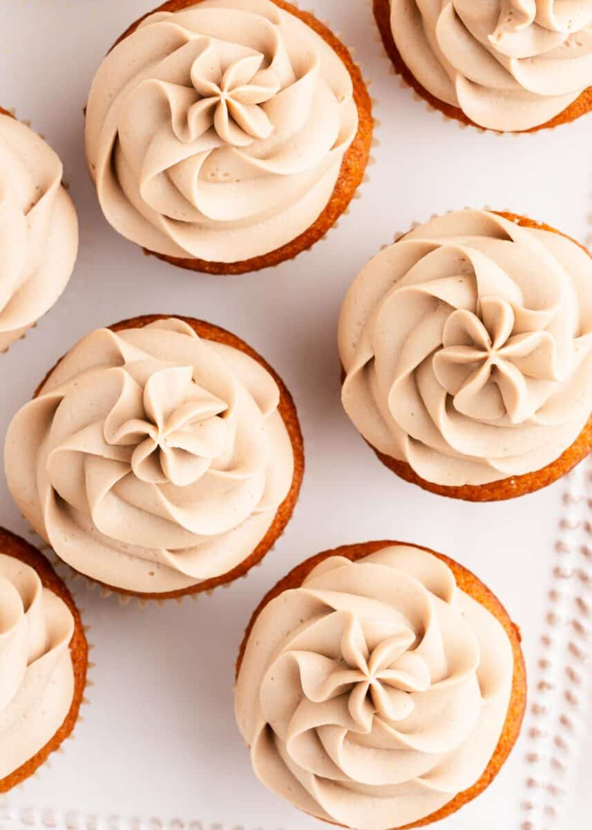 maple cream cheese frosting on top of cupcakes