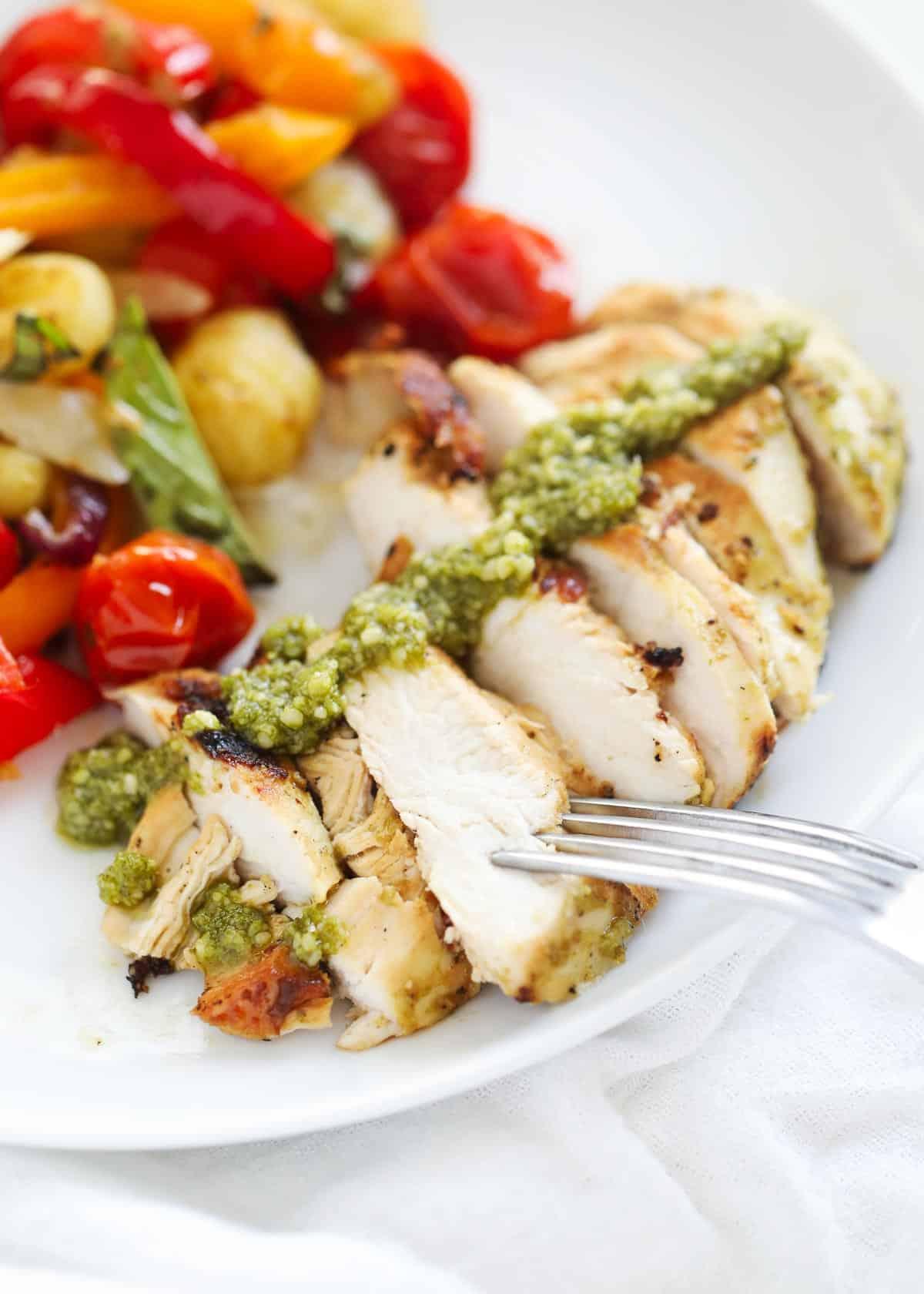 sliced pesto chicken on plate