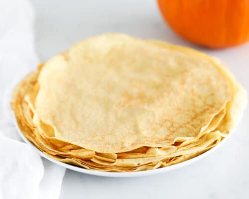 stack of pumpkin crepes on white plate