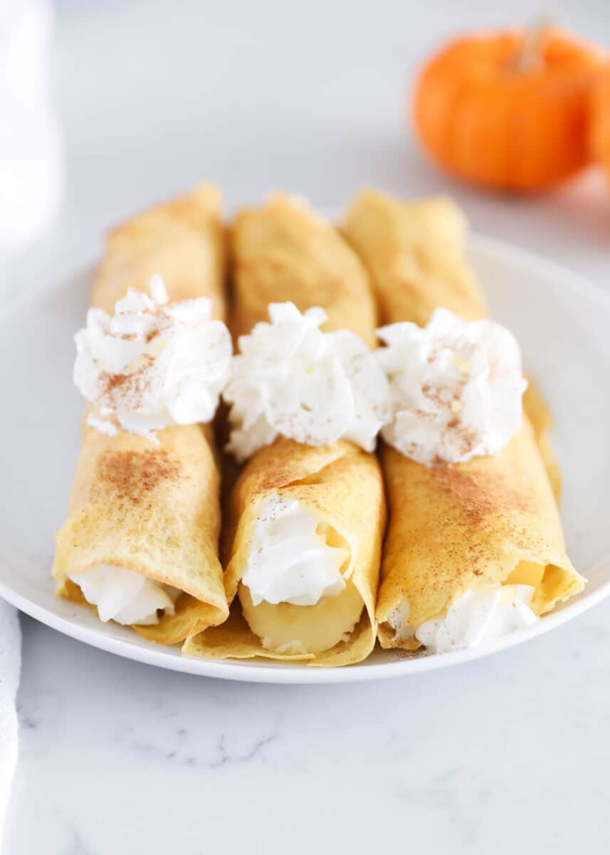 rolled pumpkin crepes with whipped cream