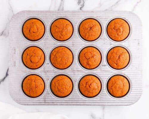 pumpkin cupcakes in muffin pan