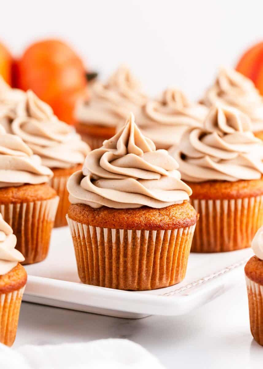 frosted pumpkin cupcakes on plate