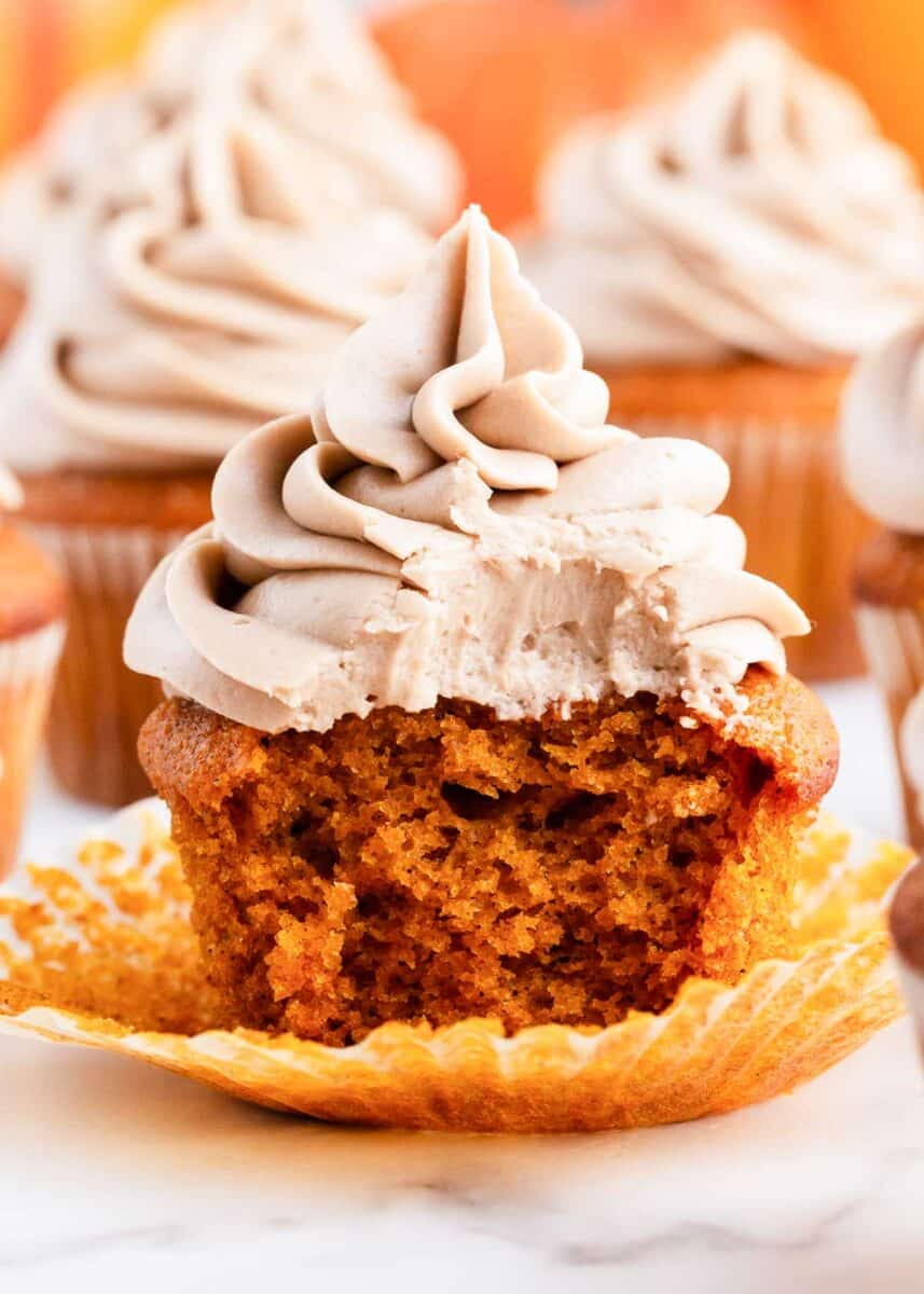 bite taken from pumpkin cupcake