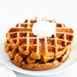 pumpkin waffles stacked on white plate