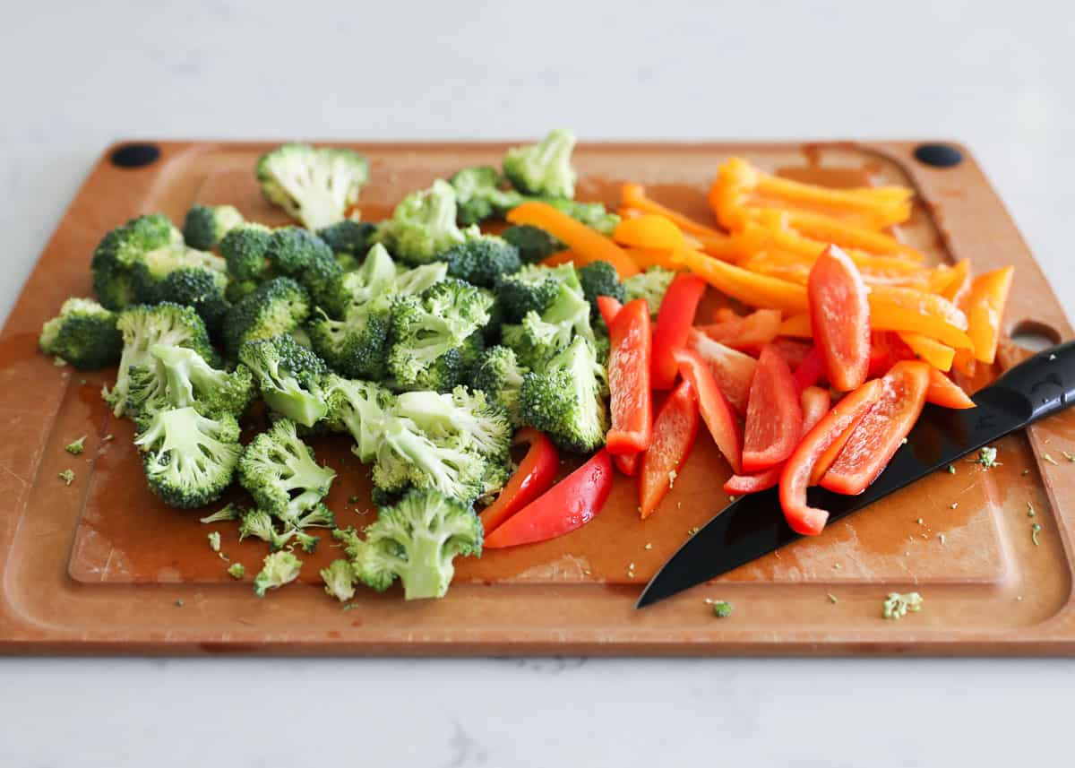 cutting vegetables on wooden cutting board