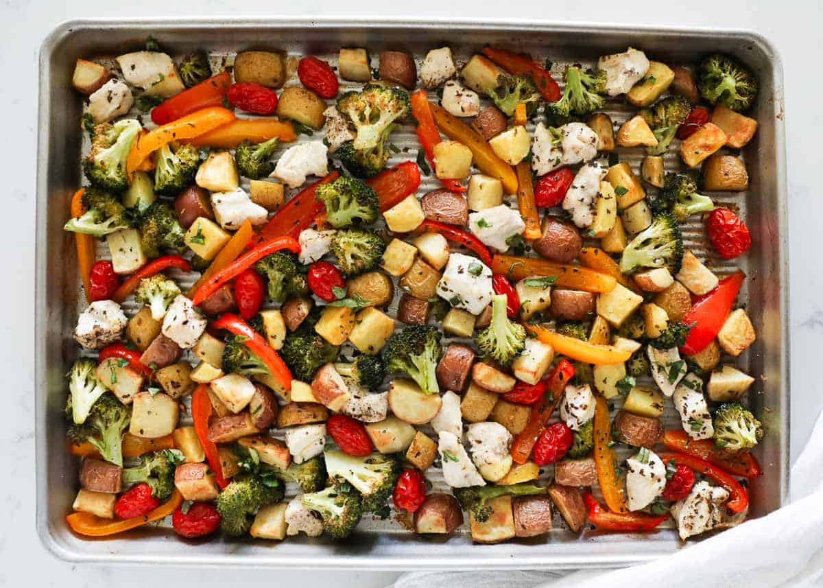 chicken and vegetables cooked on a sheet pan