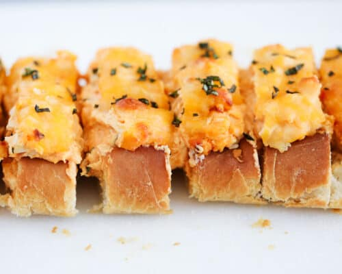 sliced stuffed french bread with cheese