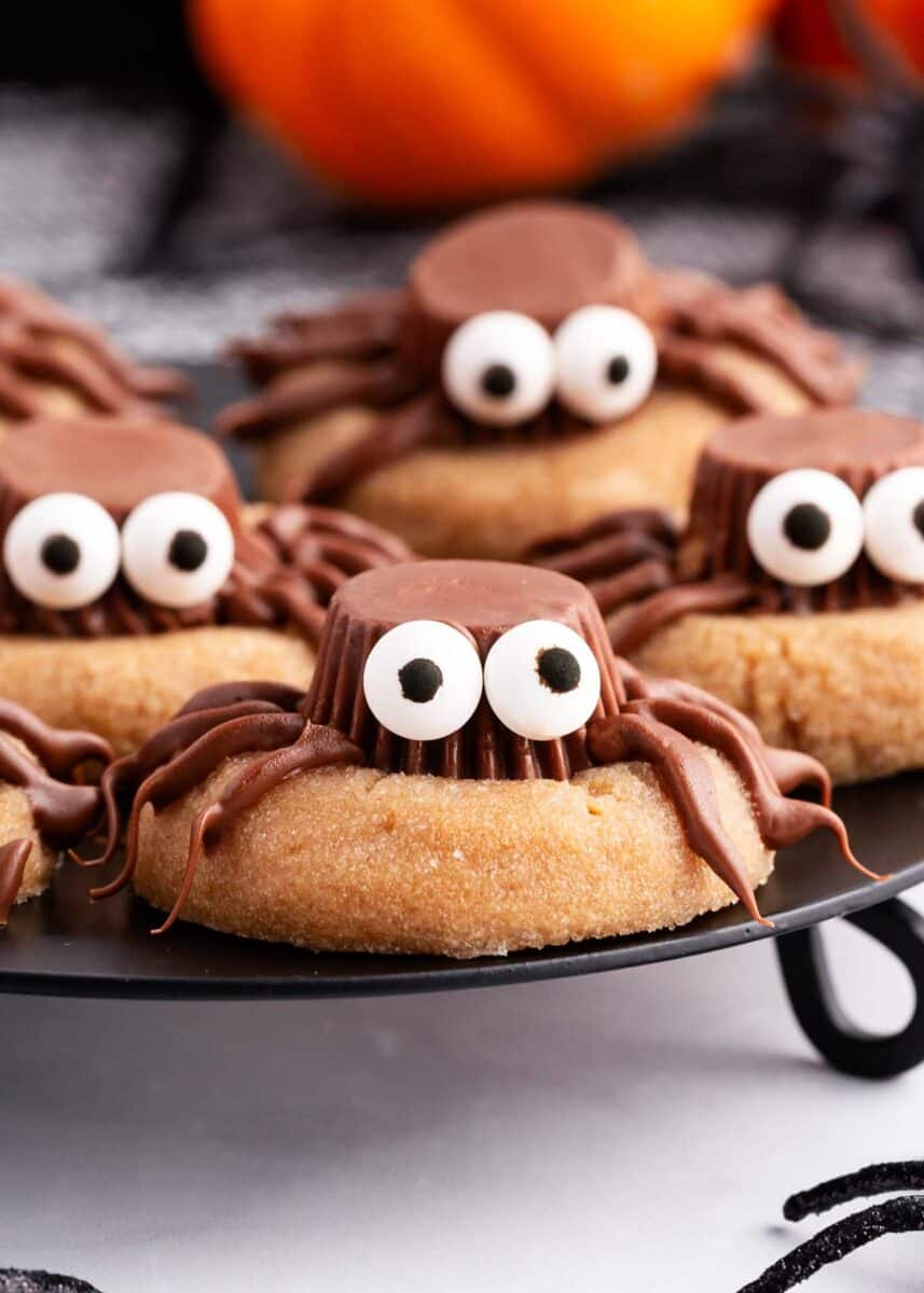 peanut butter spider cookies on black plate