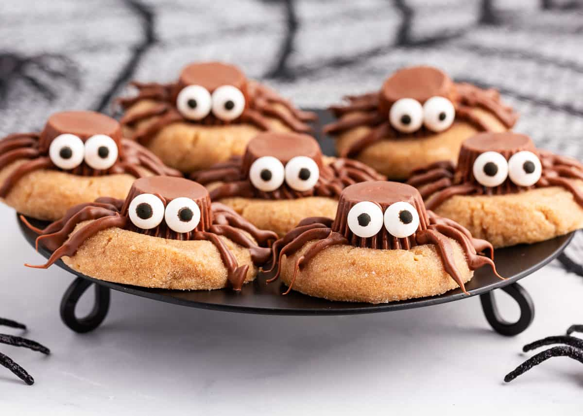 spider cookies on black plate