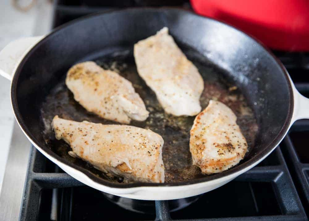cooking lemon chicken in skillet