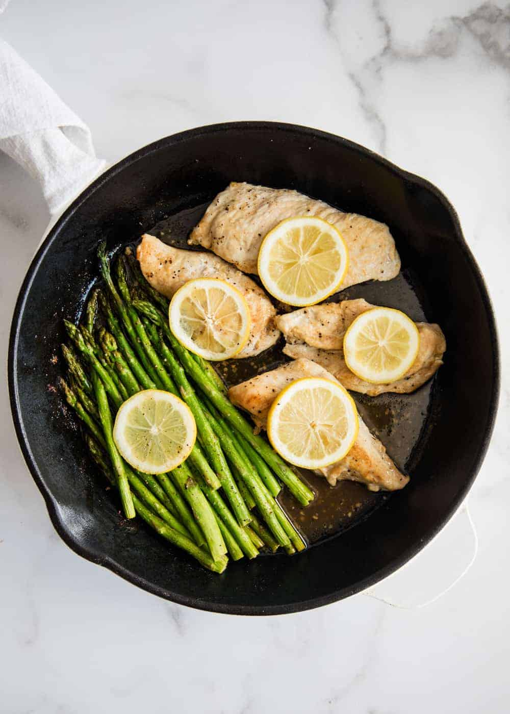 lemon chicken with asparagus in pan