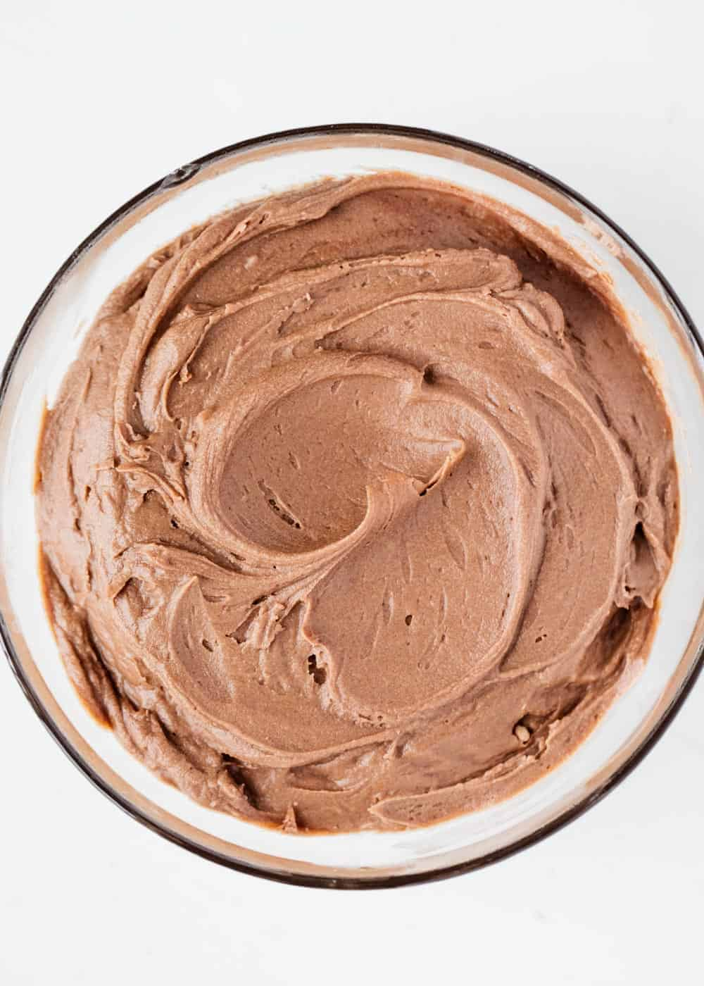 chocolate cream cheese frosting in a glass bowl