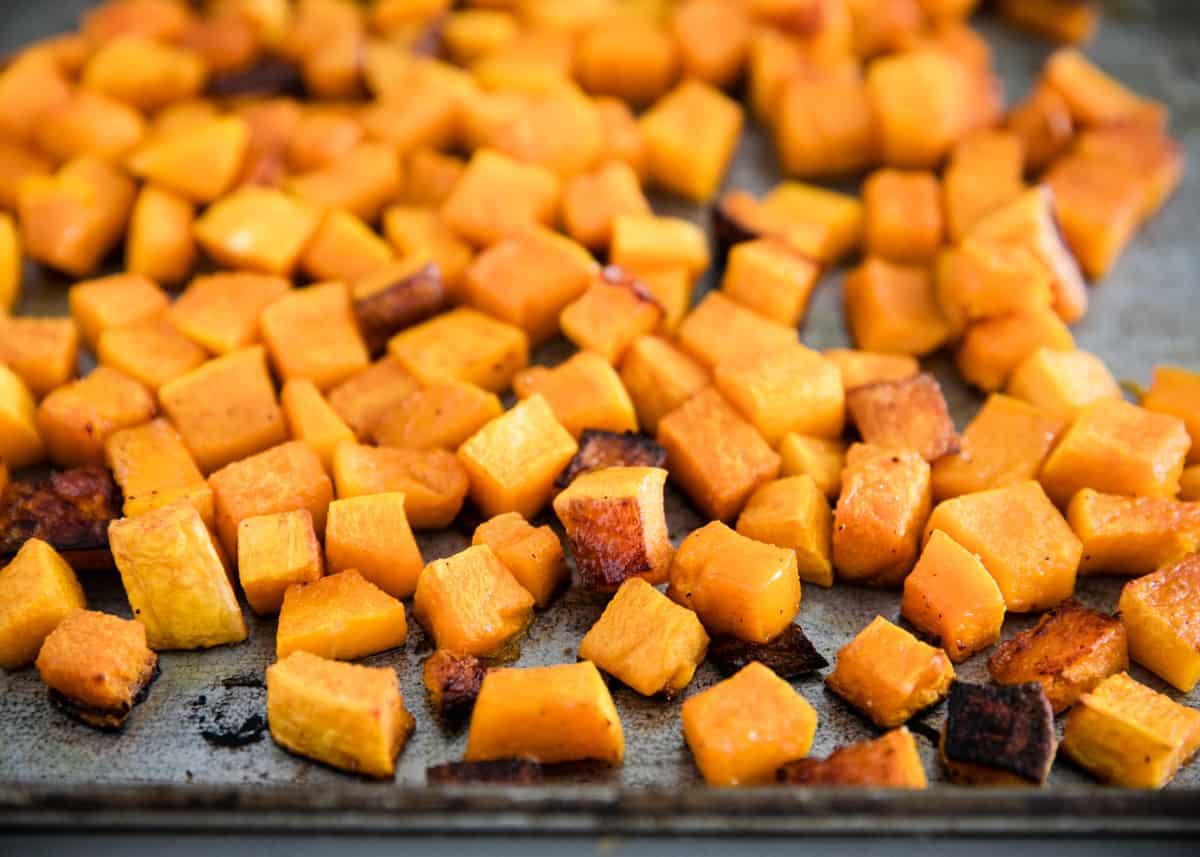 cubed butternut squash on a baking sheet