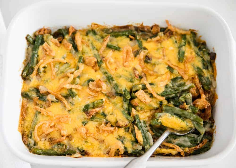 green bean casserole with cheese on top